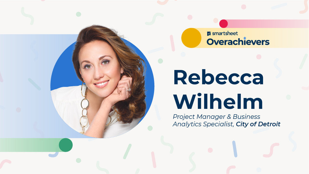Woman with brown hair smiles in a portrait. Smartsheet Overachievers. Rebecca Wilhelm project manager and business analytics specialists City of Detroit